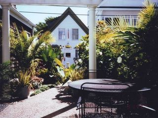 TROPICAL OUTDOOR LIVING ROOM - Provincetown condo vacation rental photo