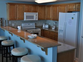 Gulf Shores condo photo - Kitchen with swivel leather bar stools...new dishwasher just added!