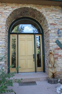 Front door of your gorgeous vacation home that opens up to a large elegant foyer