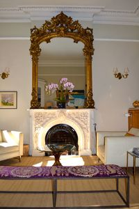 Living Room, w original mirrors and original marble fireplace