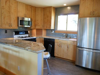 Modern kitchen completely furnished with all you need for dining in.