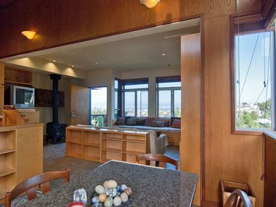 View from dining area into living room- views of City and Bay Bridge