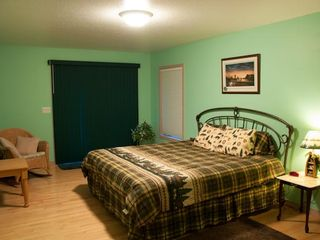 Rapid City house photo - Another upstairs room features a king size bed, walkout balcony, private bath