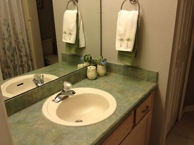 Newly appointed guest bath with linen closet.
