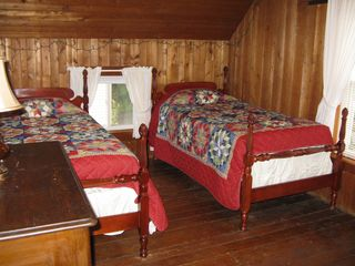 "Weirs Beach house photo - B/R 3 ""Old camp"" theme with two twin beds. Wood from ceiling to floor."