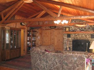 Huddleston house photo - Living Room with cathedral ceilings and cedar beams throughout