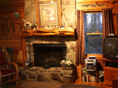 Stone Fire Place with Cedar Mantel & Gas Logs