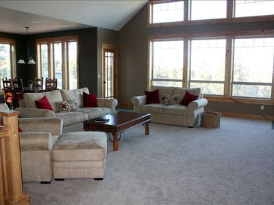 "Great room- vaulted ceiling, fireplace, 60"" tv, stunning views!"
