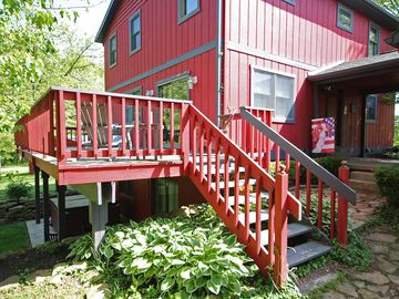 Hocking Hills farmhouse rental - back deck and hot tub on patio underneath
