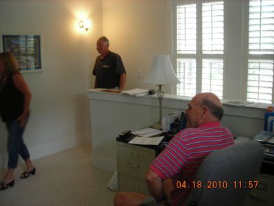 Jerry Bishop, builder, in his mezzanine office that's now a twin-bed 'bedroom.'