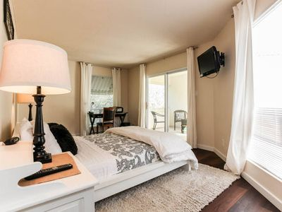Master bedroom. Queen bed. Smart TV w/local channel and movies. Private balcony