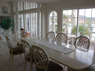 Rockport house photo - Dining room with view of canal at back of house