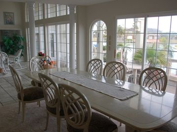 Dining room with view of canal at back of house