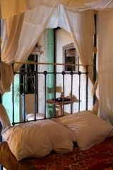 Ubud villa photo - The Bamboo House has an antique queen-size bed with a covered outdoor bathroom