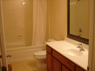 Branson condo photo - Private bathroom with framed mirror large tub