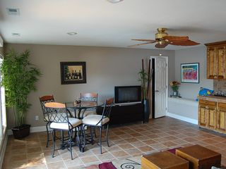 Sunrise Beach house photo - Lower family room for your enjoyment, walk out deck, flat screen TV, bar area