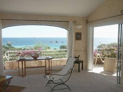 VILLA feet in the water on the beach of Palombaggia, with 5mn with feet by private access. Exceptional view of the sea and the islands.