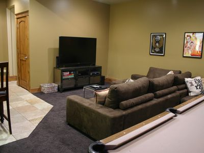 Game room with 60-inch HDTV and pool table