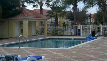 2nd view of pool with hot tub and view of bathrooms. One minute walk from our ho
