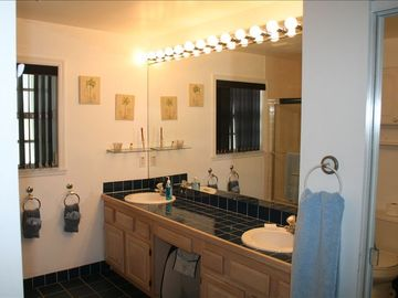 His & Her Dual Vanity Sink with countertop space.