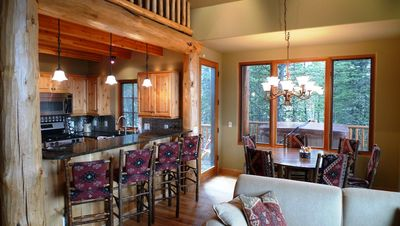 Great room opens to kitchen, dining, views and hot tub on deck.