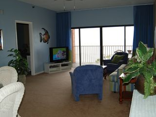 Redington Shores condo photo - The great room includes beautiful water views and a large HD TV!