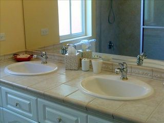 Los Suenos Resort condo photo - Ensuite bathroom with double sinks and a combination bath/shower.