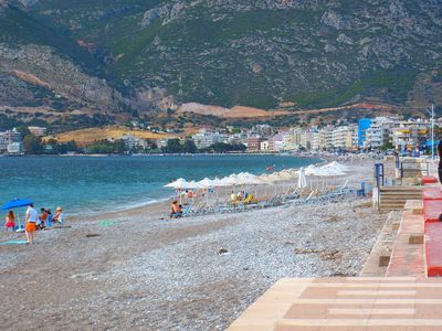 Beautiful Loutraki Beach and Geranian Mountains backdrop