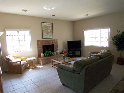 "Living room has 42"" flatscreen TV,  CD player, gas fireplace, full-size sleeper"