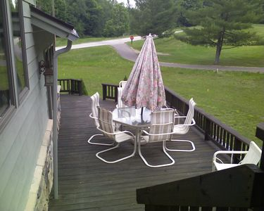 Back deck with seating and grill