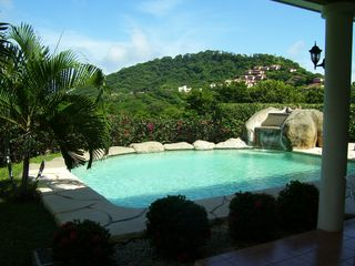 Playa Hermosa house photo - Photo from our private pool with great views of the ocean and hilltop villas.