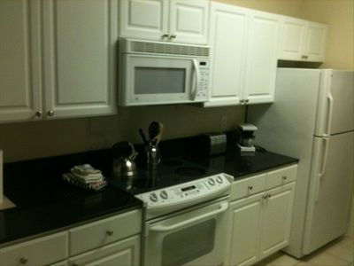 Granite countertops, range, fridge, microwave, disposal, dishwasher and pantry