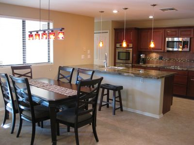 Dining and Kitchen with Beautiful Granite Countertops