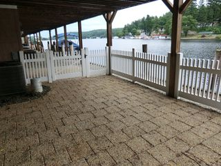 Patio with gate to boat dock - Alton Bay condo vacation rental photo