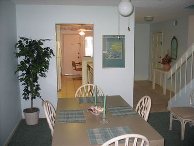 Dining room with kitchen and entry way view