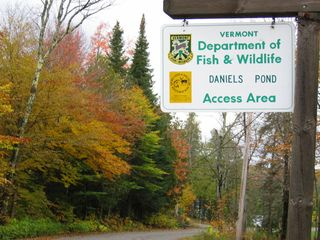 Glover house photo - Welcome to Daniels Pond sign