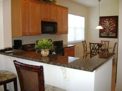 Large Gourmet Eat-in Kitchen with Granite Counter Tops