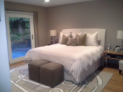 Master bedroom with view of the pool and access to backyard. Very restful.