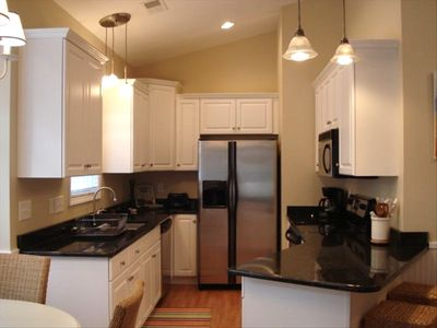 Fully Furnished Kitchen with Granite Countertops & Stainless Steel Appliances