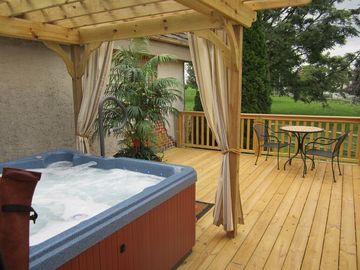 Hot tub with small table for two