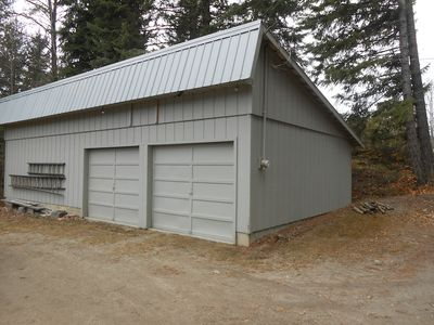 Two-car garage with large parking area