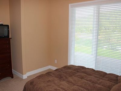 Queen bed w/ walk out - a great view of the lake to wake up to every morning.