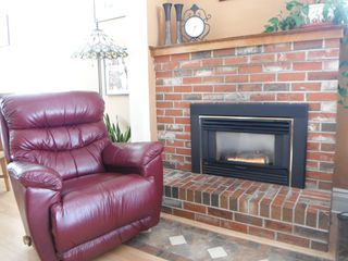 Crowsnest Pass house photo - Perfect spot to relax with a book by the fireplace.