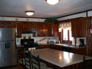 Jefferson farmhouse photo - Spacious kitchen with seating for four at the island