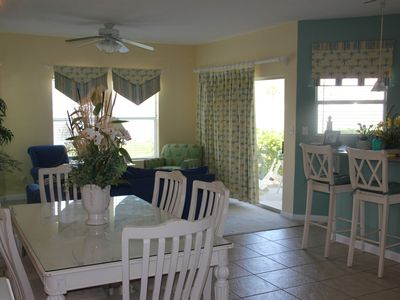 Dining area view, breakfast bar & family room.