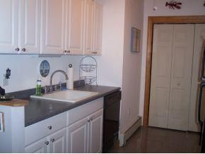 Manahawkin house photo - galley kitchen with washer and dryer in closet