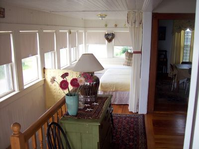 Inviting entry with sun porch area that converts to sleeping for 2