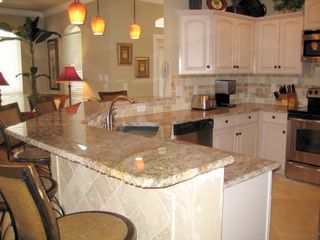 Emerald Shores house photo - Custom Gourmet Kitchen with Rock Faced Edge Granite