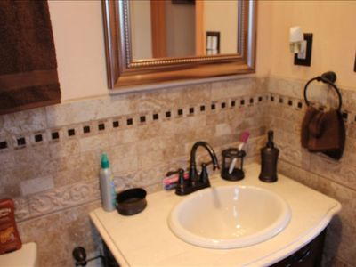 Brand New master Bath with walkin shower, all Italian tile.  Walks thru toPool