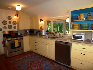 Healdsburg cottage photo - Updated, well equipped kitchen features new appliances and colorful dinnerware.